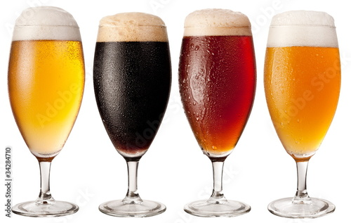 Four glasses with different beers Poster