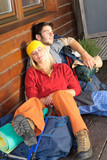 Tramping young couple backpack sleep by cottage poster