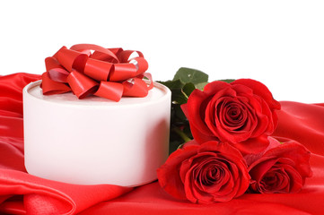 Red rose with a box with a gift