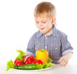 A boy and the plate of vegetables