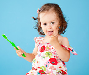A little girl with a toothbrush