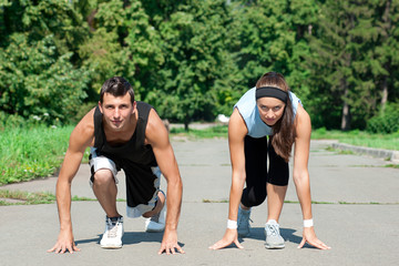 Fitness couple ready to start running