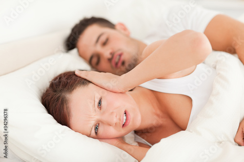 Woman not wanting to hear snoring