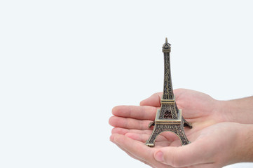 Layout Eiffel Tower on your hands man, isolated