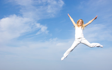 Beautiful blond girl flying in the air, concept of freedom