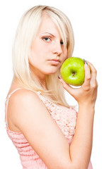 Beautiful blonde girl with fresh green apple