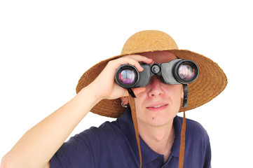 Young man with binoculars and straw hat
