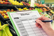 Hand with Pen Writing a Diet Plan by Supermarket Fruit - 34303360