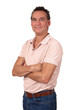 Attractive Smiling Middle Age Man in Polo Shirt and Jeans