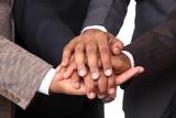 stacked hands, symbolizing team-effort poster