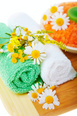 Spa concept: the towel, flowers and candles isolated over white