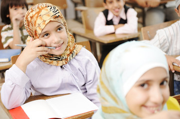 Muslim girl student in classroom thinking