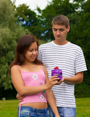 Young Man Giving Present To Girlfriend