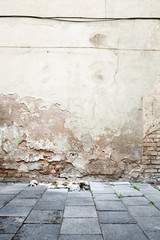 Aged textured street wall background