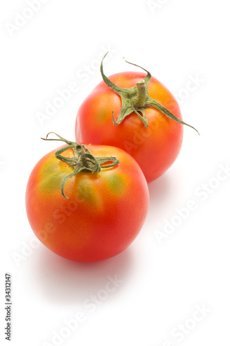 Two immature tomato