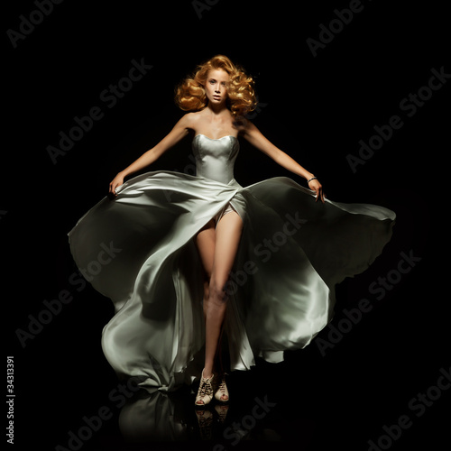 Cute blond lady on black background