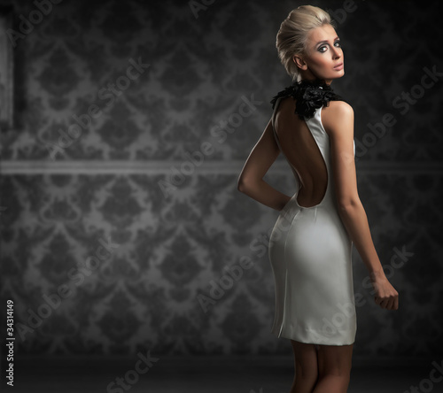 Sexy woman wearing white dress