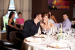 happy couple at restaurant table kissing