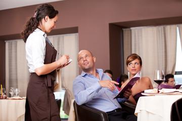 waitress taking the order from restaurant table