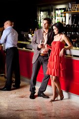 young couple in bar having fun