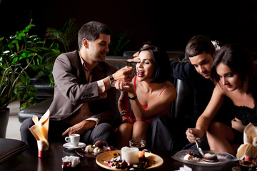 young couples having deserts and coffee