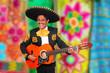 Charro Mariachi playing guitar serape poncho
