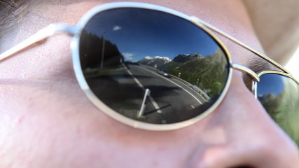 Swiss Alps mirrored in a pair of sunglasses