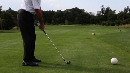 Golf player teeing off on a beautiful golf course