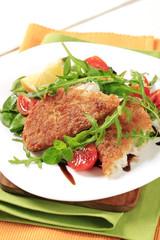 Fried fish and fresh salad