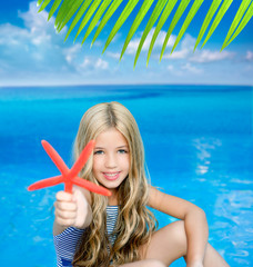 children blond girl in summer vacation tropical beach