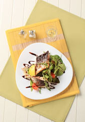 Salmon trout fillets and salad greens