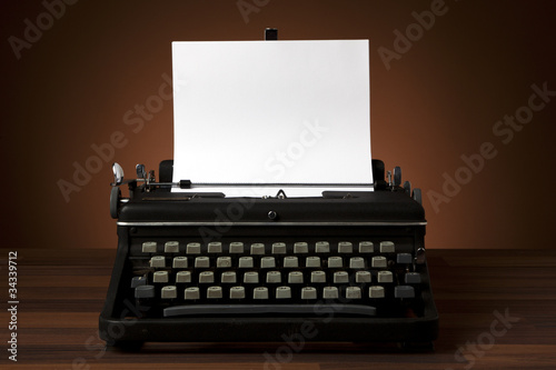 old typewriter with blank paper