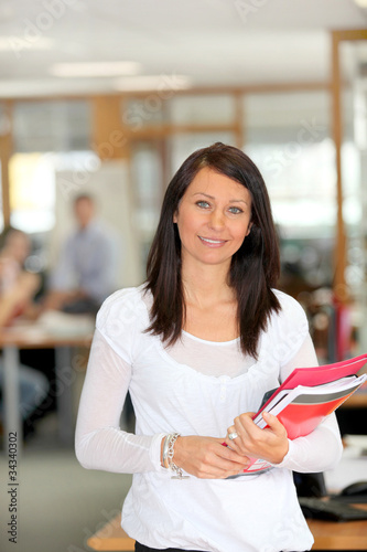 Attractive brunette with office files