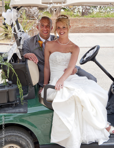 Bride and Groom on a Golf Cart
