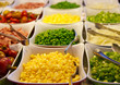 Corn and Fresh Vegetables on a Salad Bar