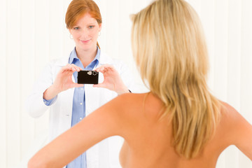 Plastic surgery female doctor shoot patient breast