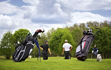 Golf bags with group of players