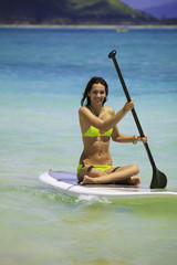 young woman on a standup paddle board