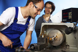 Two technicians on lathe machine in workshop poster