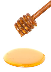 honey dripping from dipper