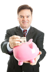 Happy Businessman Saves in Piggy Bank