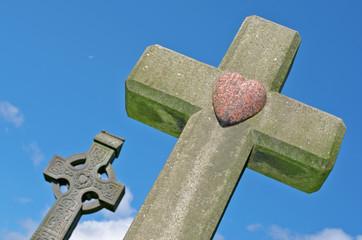 Marble heart on granite cross