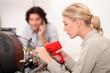 TV repairwoman with a soldering gun