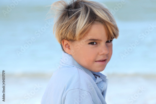 Little boy relaxing at the beach