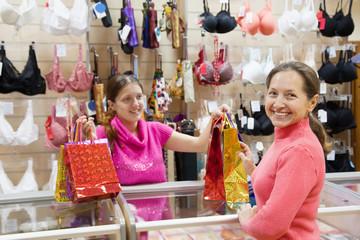 Buye at  counter in underwear shop