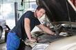 Mechanic Portrait Working on Car