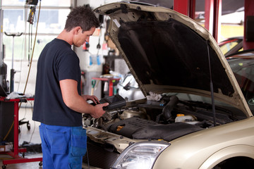 Mechanic Servicing Car
