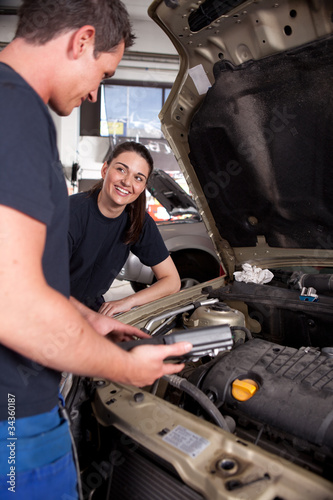 Man Woman mechanic Team