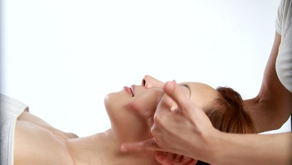A woman having facial massage