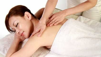 A woman having back massage